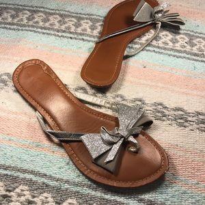 Sparkly bow flip flops